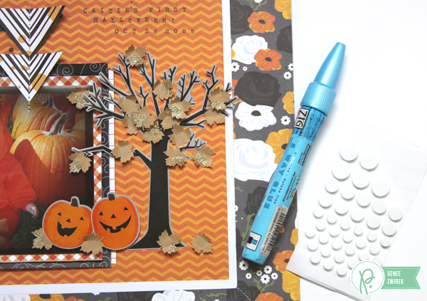 creating a framed look for Baby's First Halloween with this Pumpkin layout by @reneezwirek using the #Thirty-One #Halloween collection by @Pebbles Inc.