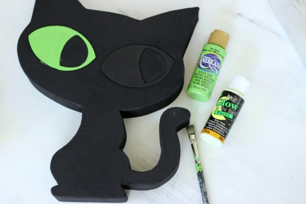 Paper Mache Halloween Black Cat painted with glow in the dark paint created by @ribbonsandglue