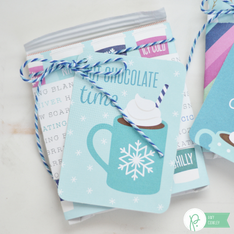 Create these cute and simple Hot Cocoa Gifts with the #WinterWonderland collection from @pebblesinc and this tutorial from @thehappyscraps.