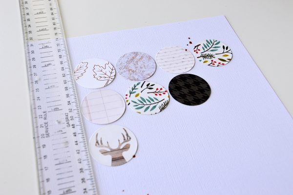 Create a fun textural background for your next layout with @PebblesInc patterned papers by hand stitching circles just like @leanne_allinson.