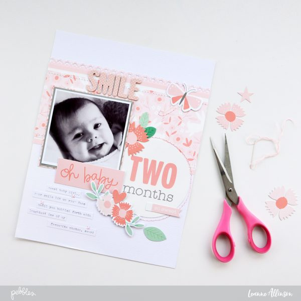Learn how to add simple stitching to enhance your layouts with @PebblesInc #LullabyCollection and @leanne_allinson.