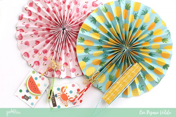 These DIY Paper Fans are going to be a hit on your next party! Just follow this tutorial from @evapizarrov using the new #SunshinyDays collection by @pebblesinc #pebblesinc #madewithpebbles