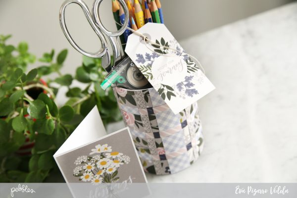 @evapizarrov shows you how to use your favorite patterned papers from the Heart of Home collection by @pebblesinc to create this cute woven pen holder for this back to school season #pebblesinc #madewithpebbles