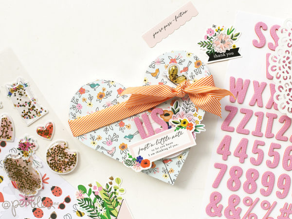 Create a heart shaped box and a mini album with this tutorial from @evapizarrov using the new #heyhello line from @pebblesinc #madewithpebbles #pebblesinc